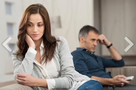 woman sitting with husband