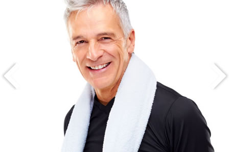 Smiling man with towel on shoulders